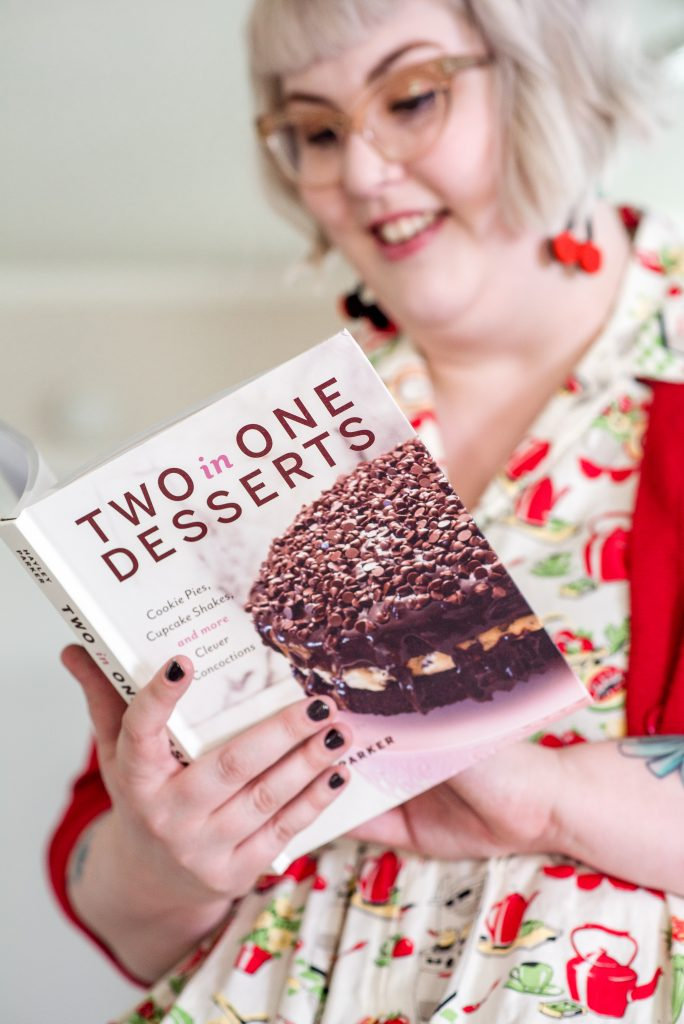 photo of author holding her cookbook, two in one desserts