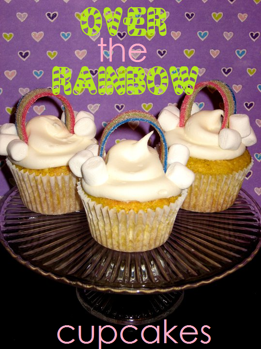 Over the rainbow cupcakes on a clear platter