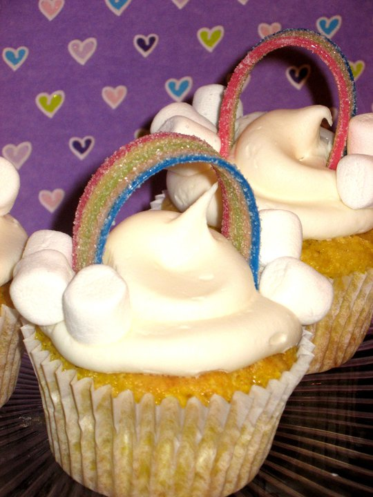 Over the rainbow cupcakes with a purple heart background