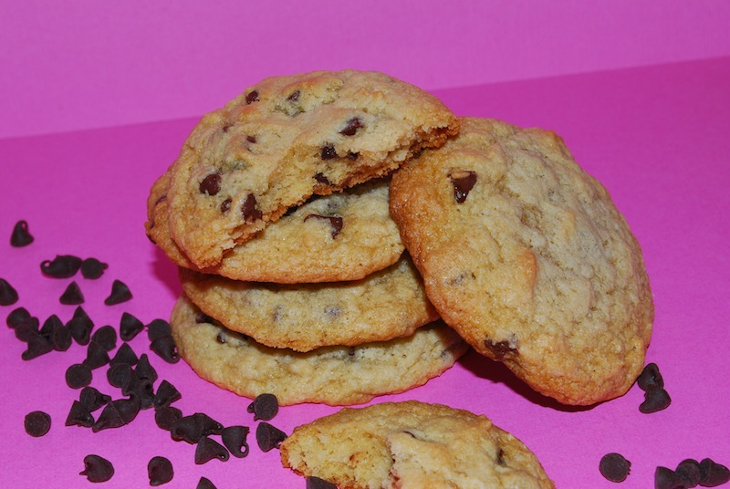 closeup stack of low-calorie chocolate chip cookies on pink background