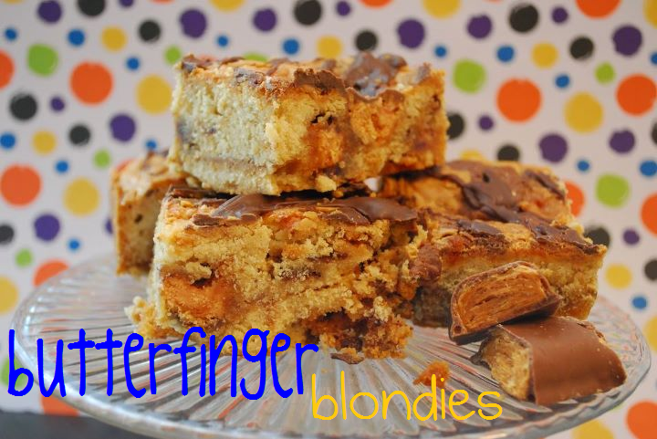 Multiple Butterfinger blondies on a platter in front of a polka dot background