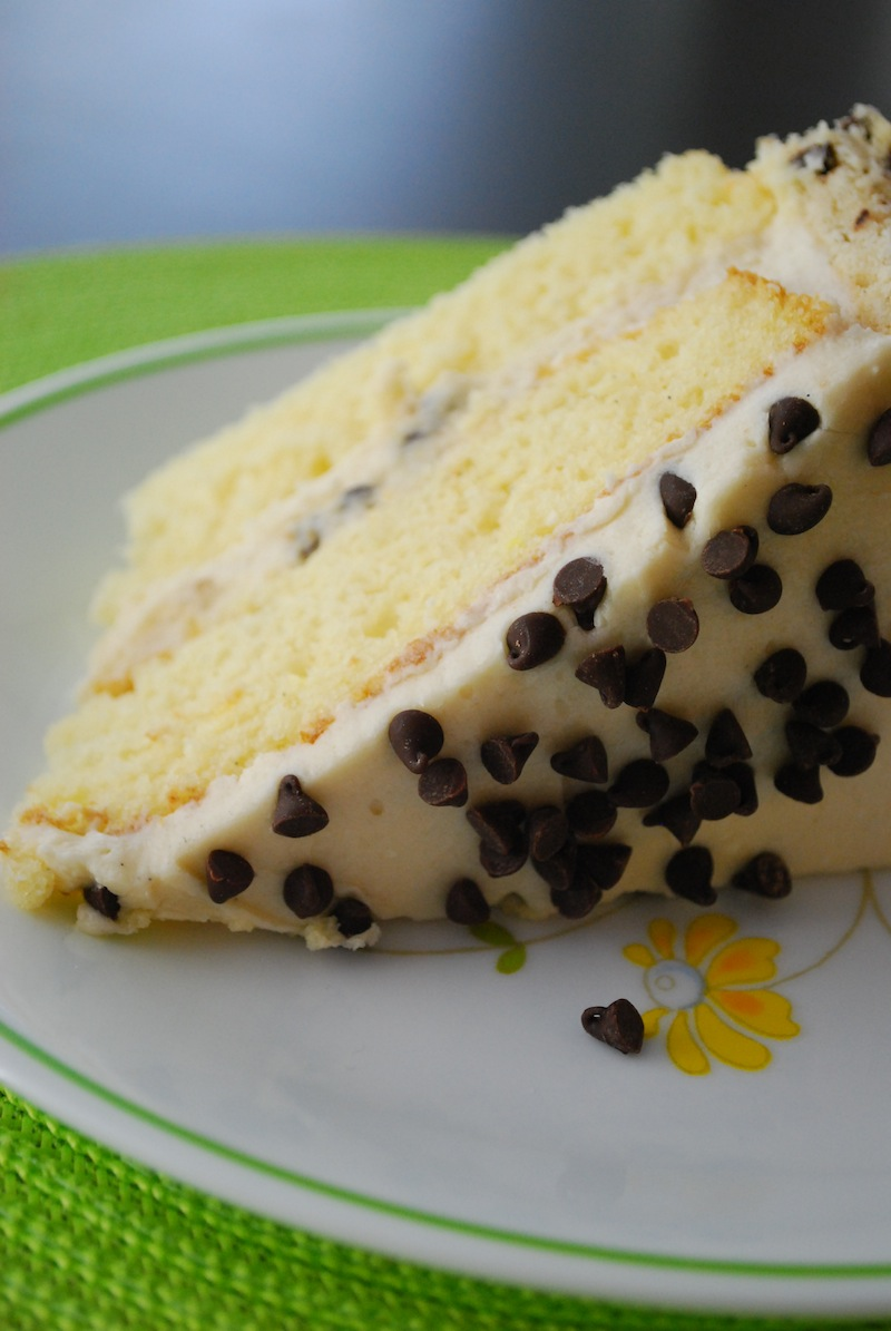 a slice of chocolate chip cookie dough cake on a white floral plate