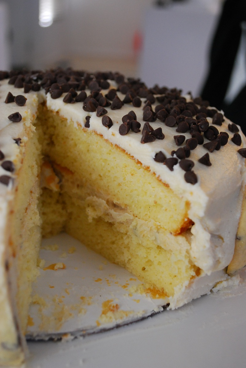 a photo of the interior of a chocolate chip cookie dough cake