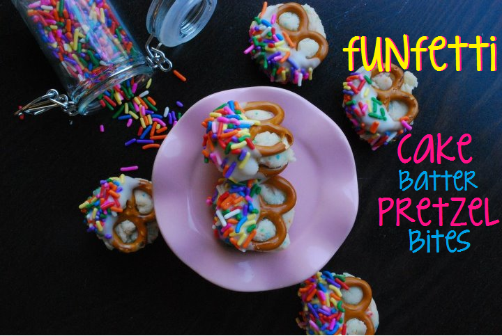 funfetti cake batter pretzel bites on a pink cake stand with sprinkles