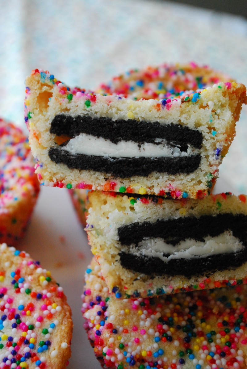 A few sugar cookie covered Oreos with one cut in half to show the Oreo inside