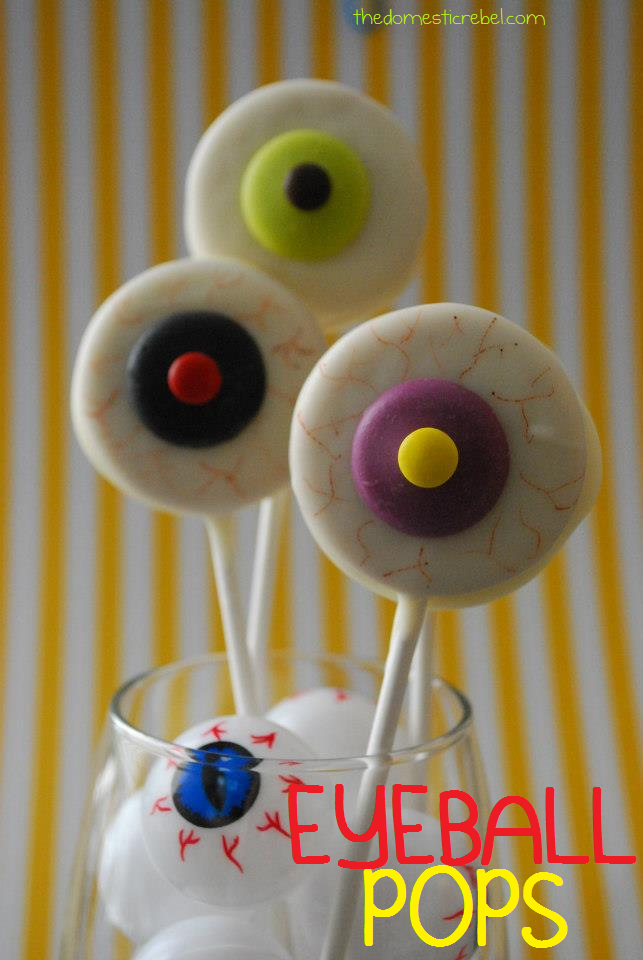 Eyeball Oreo pops in a jar of plastic eyeballs