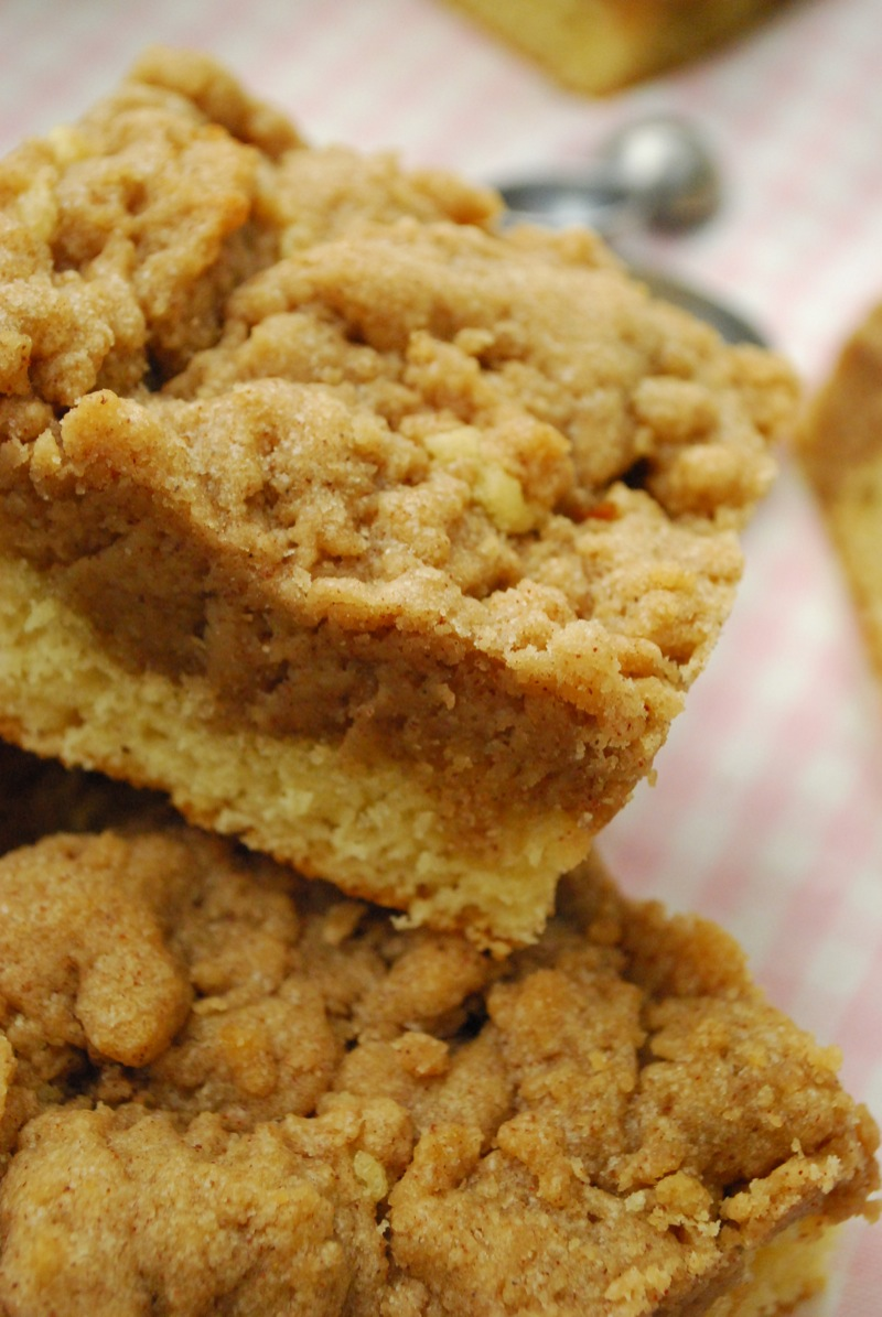 Close-up of a few super crumb cake squares on a checkered cloth