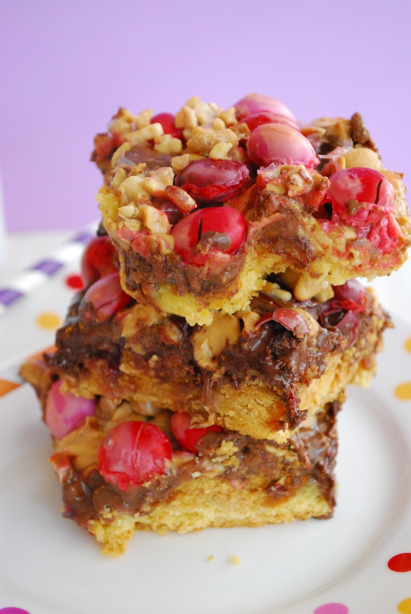 peanut butter & jelly seven layer bars stacked on a plate