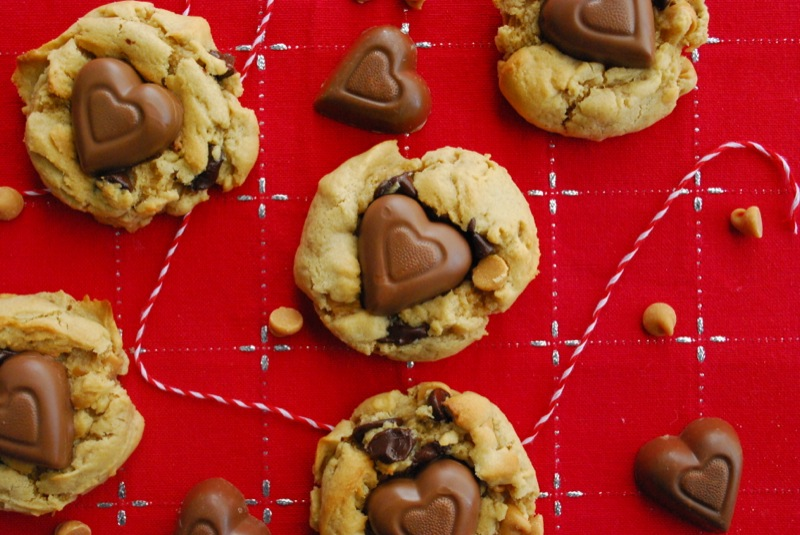 chocolate peanut butter heart chip cookies arranged on a red cloth