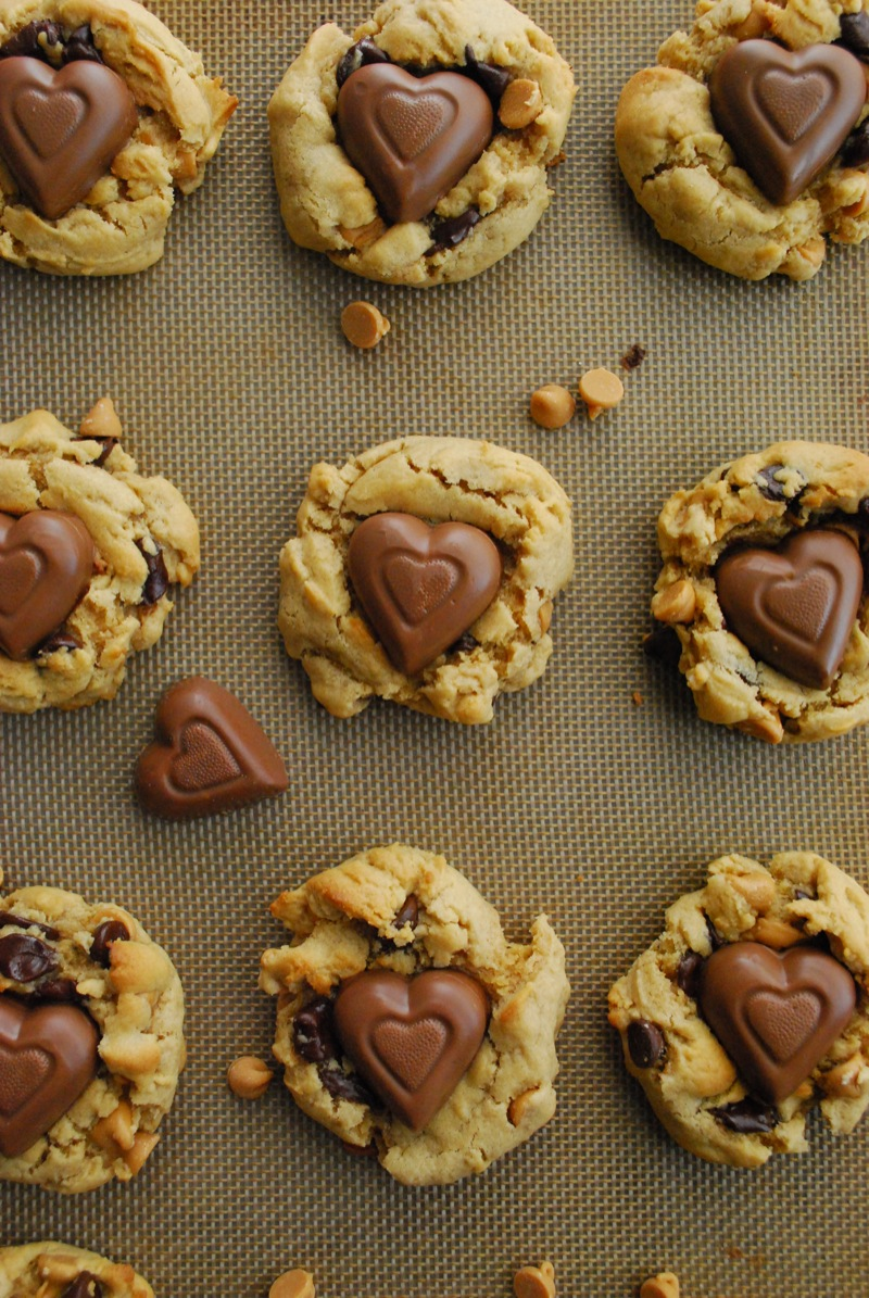 chocolate peanut butter heart chip cookies lined up on a baking sheet