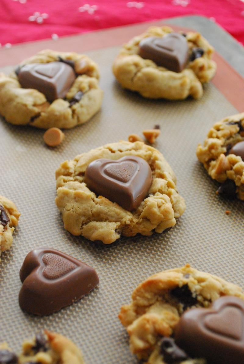 chocolate peanut butter heart chip cookies arranged on a baking sheet