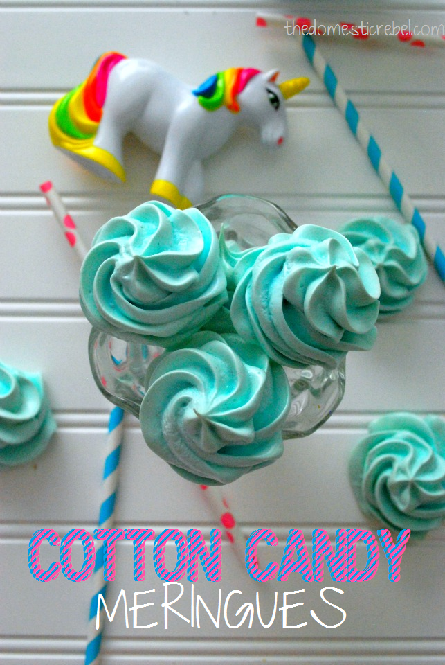 Cotton candy meringues on a white background with straws and a toy unicorn