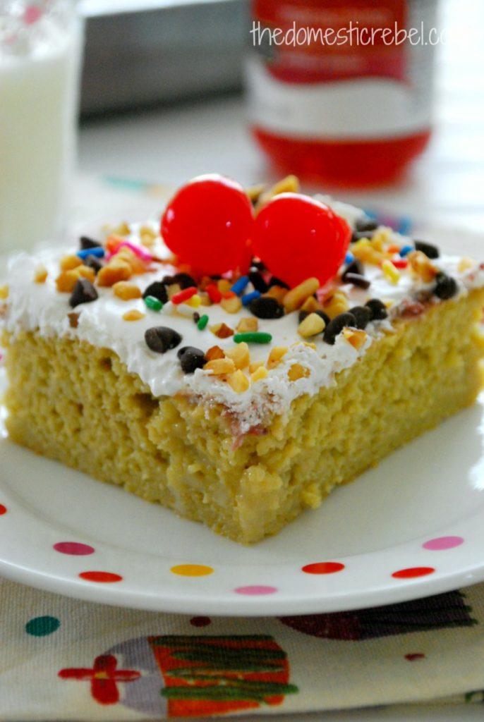 banana split poke cake on a polka dotted plate
