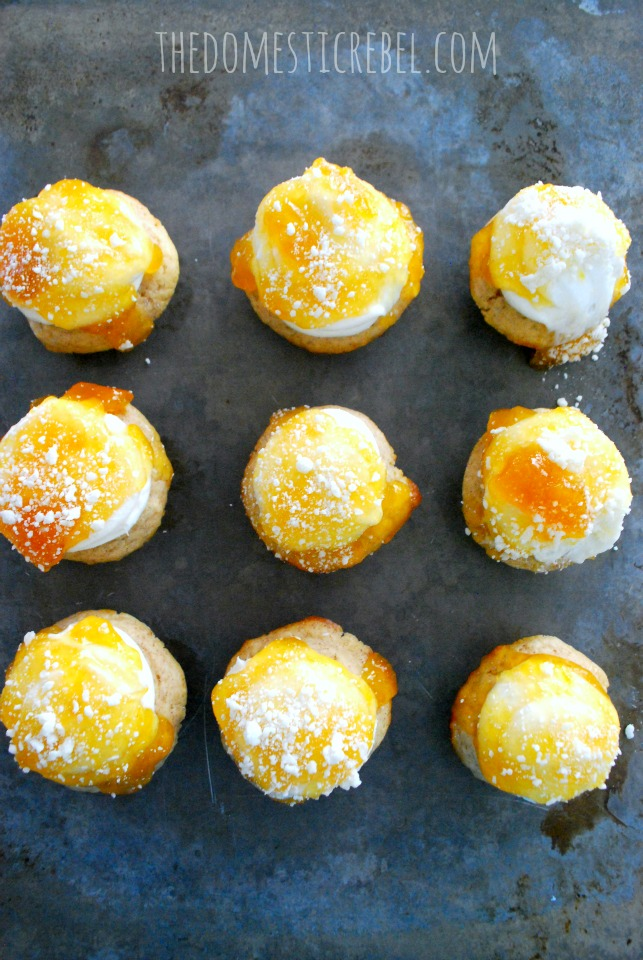 son of a peach donut cupcakes arranged in a grid on a metal baking sheet