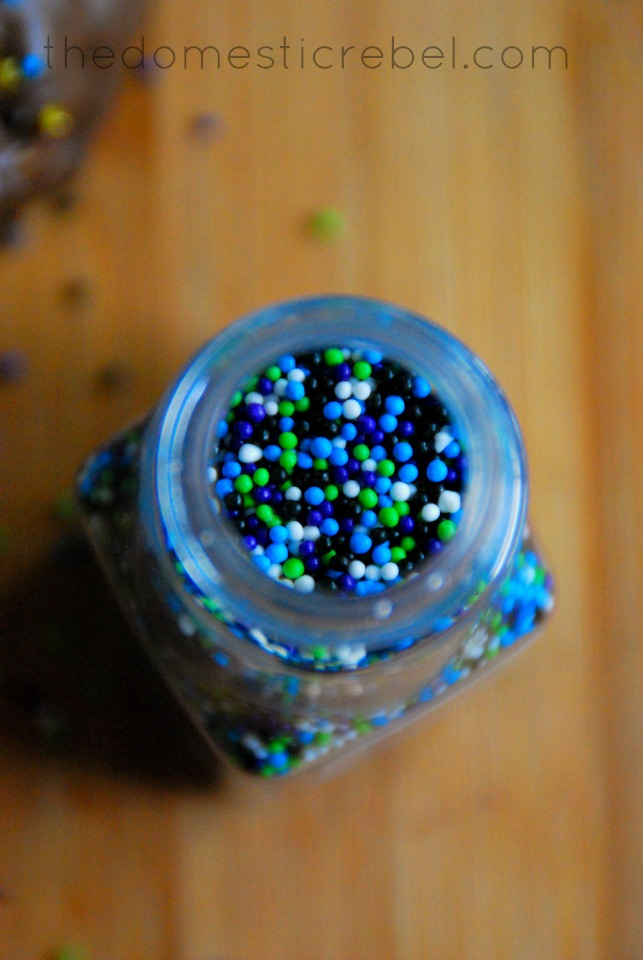 photo of sprinkles in a bottle on wood background