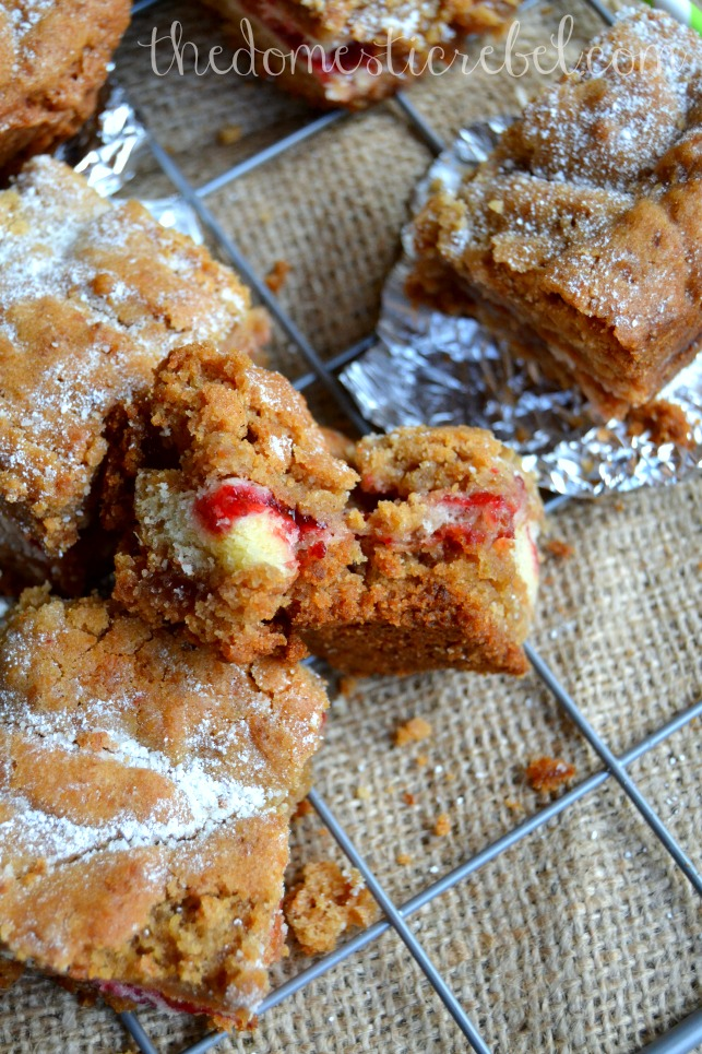oatmeal cookie peanut butter and jelly donut bars cut in pieces on a wire cooling rack