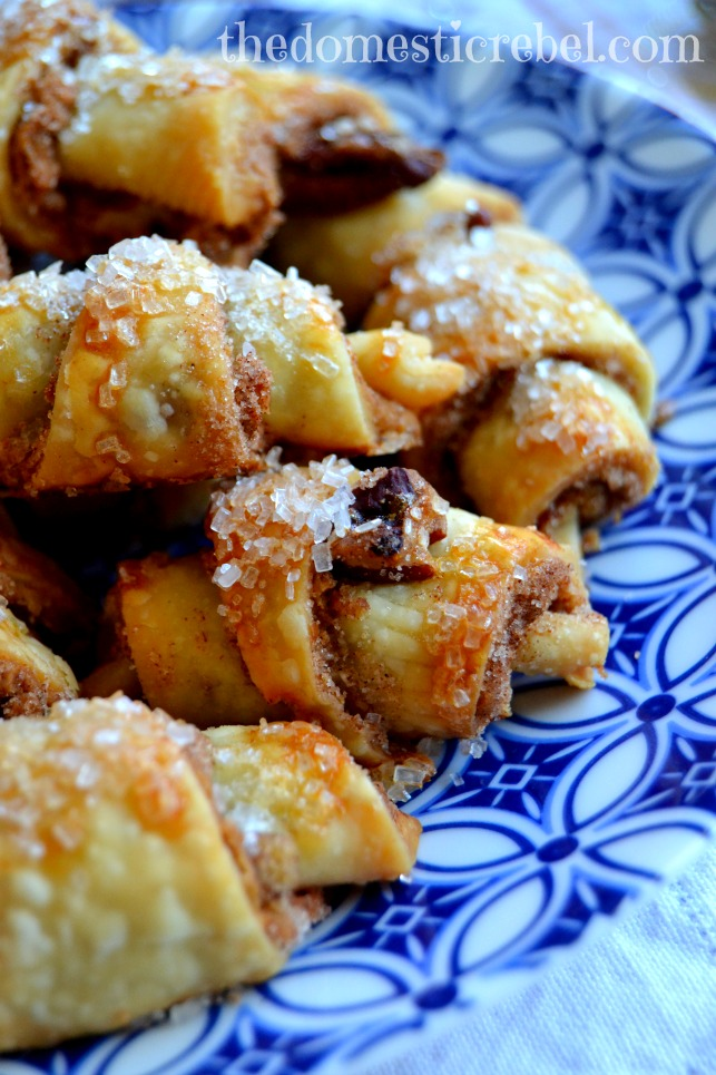 gingerbread biscoff rugelach cookies arranged on blue and white plate