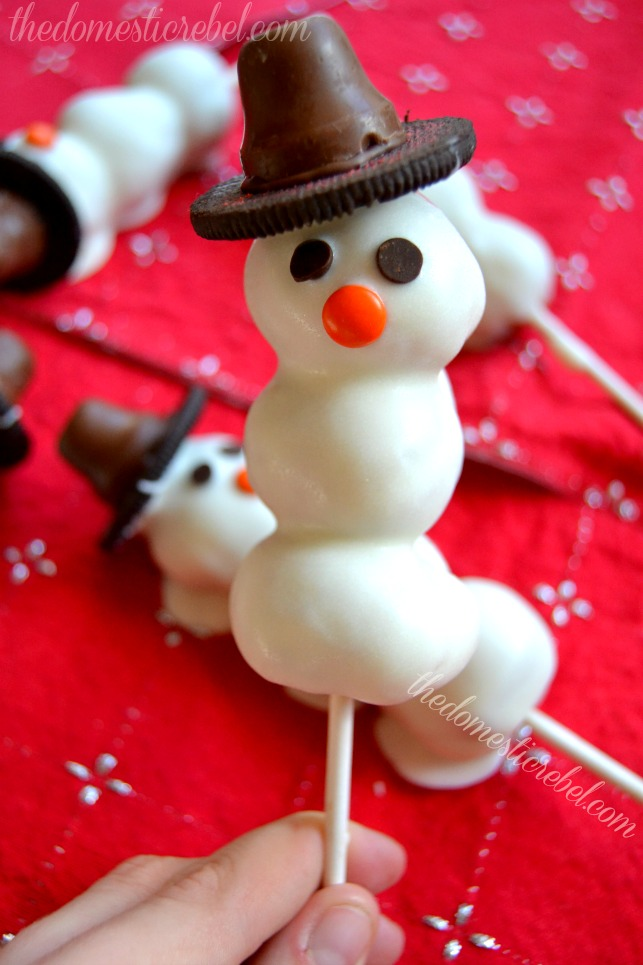 snowman donut pops on a red background