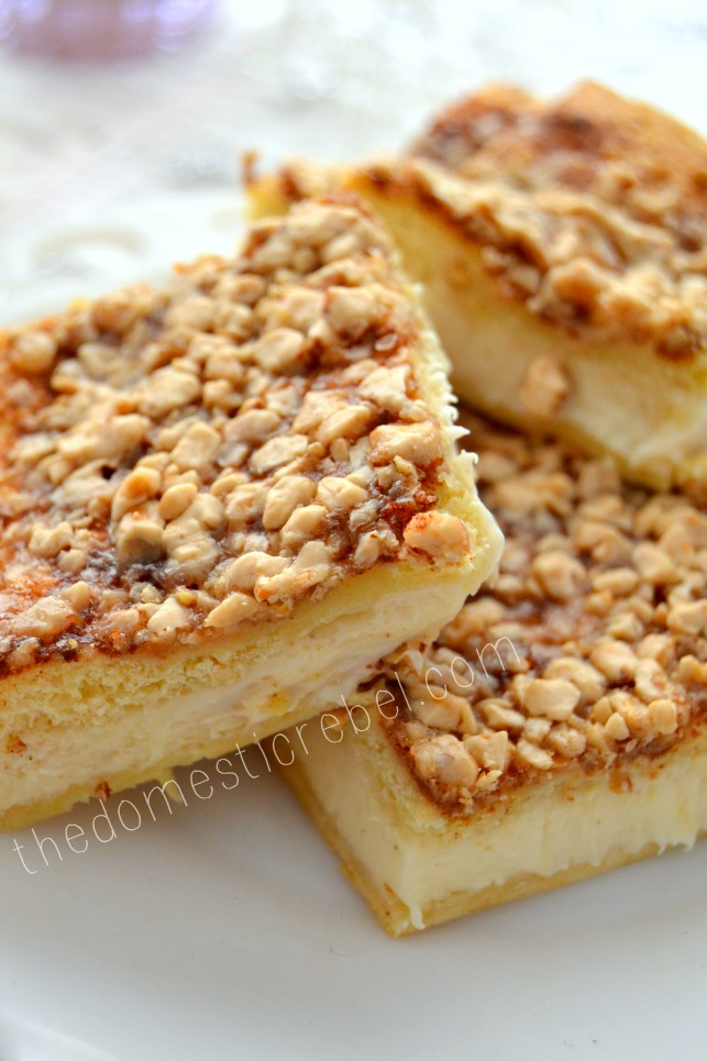 eggnog brulee cheesecake bars piled on white plate