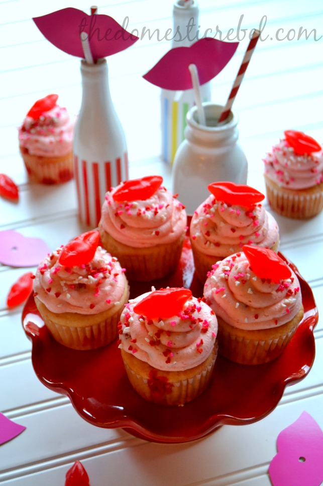 red hot cinnamon cupcakes arranged on red plate on white background