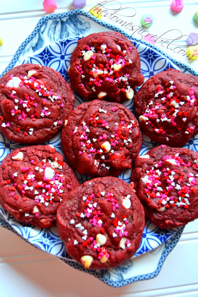 red velvet m&ms cookies on a blue and white plate