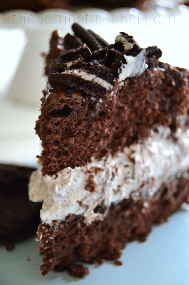oreo overload cake slice up close on blue plate