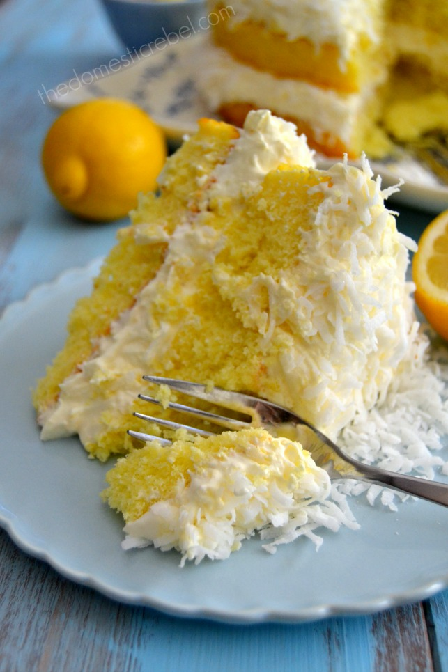 guiltless lemon coconut cake slice on blue plate with fork