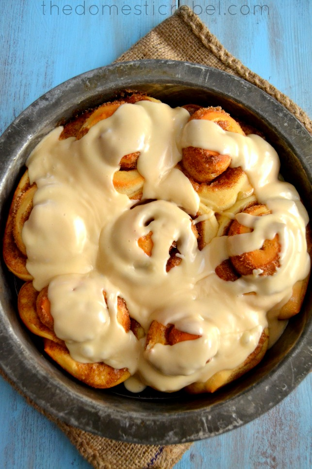 best one hour cinnamon rolls in a metal pan on a blue background