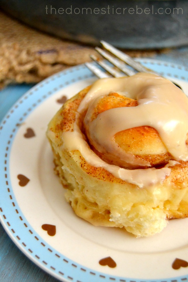 best one hour cinnamon roll on a blue and white plate with a fork