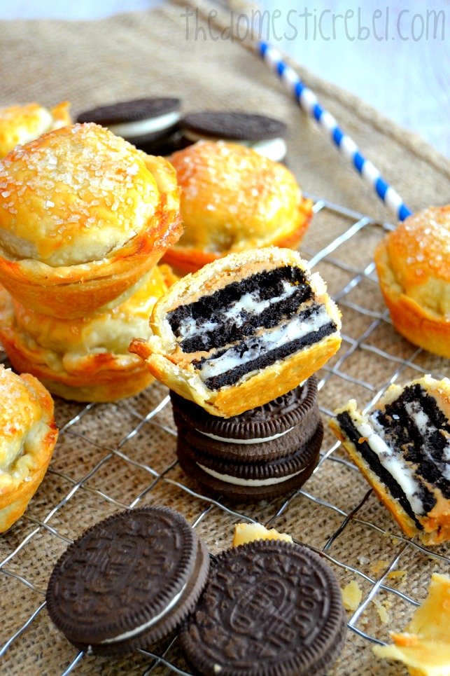 oreo peanut butter pies arranged with oreo cookies on wire rack