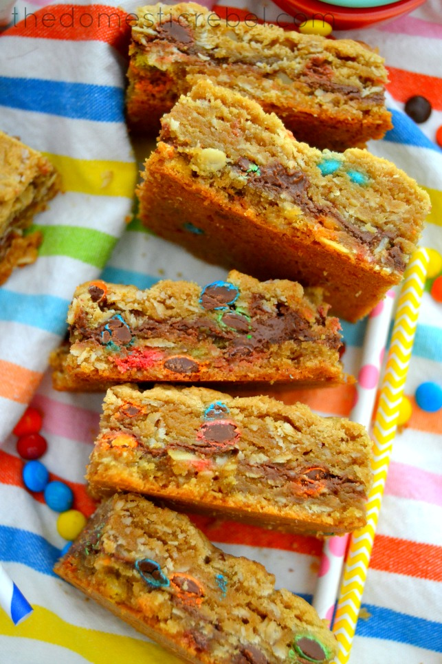 nutella-filled monster cookie bars arranged on a rainbow dishtowel