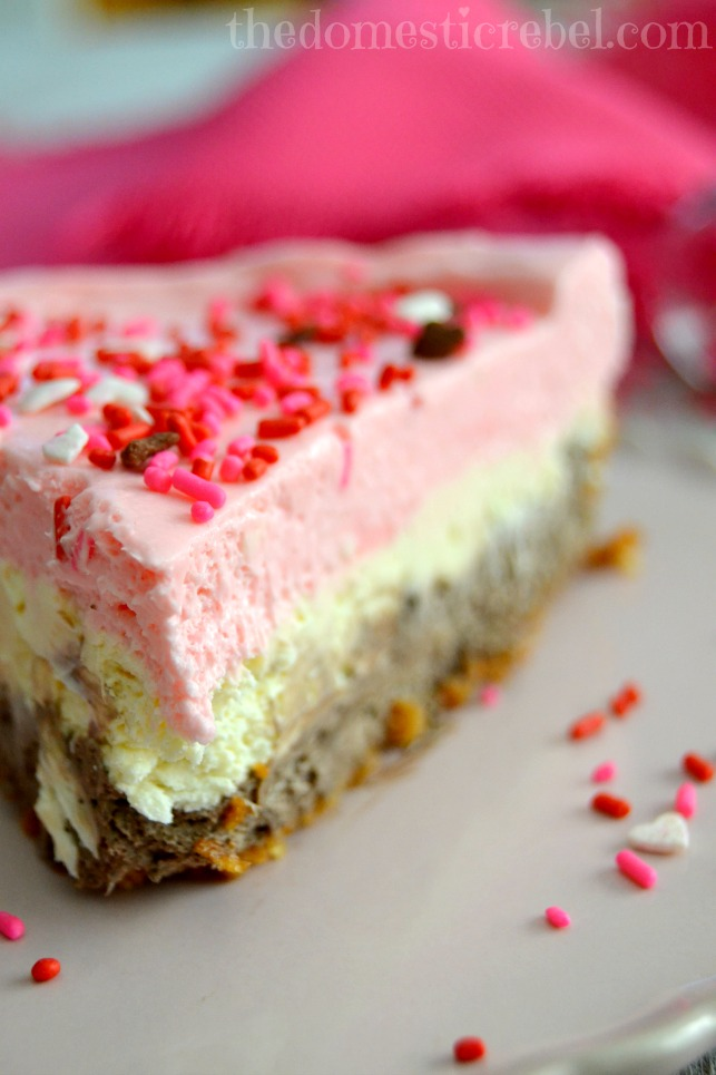 neapolitan no bake cheesecake closeup of slice on pink plate