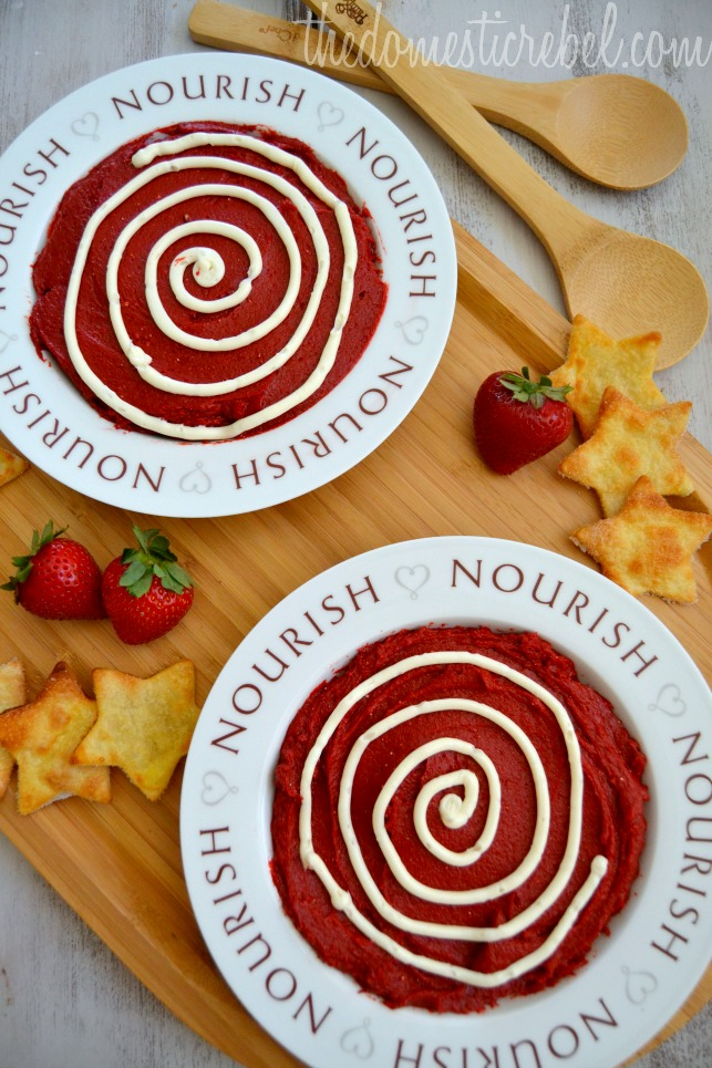 "red velvet dessert dip recipe arranged in bowls that say ""nourish"" with berries and pie crust dippers"