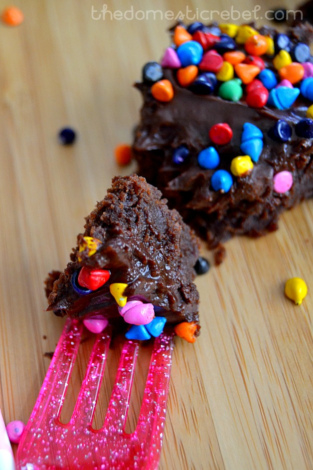 copycat cosmic brownie with a piece on a pink glittery fork