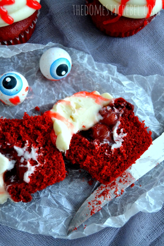 bloody eyeball halloween cupcakes interior with knife and eyeball gumballs on parchment