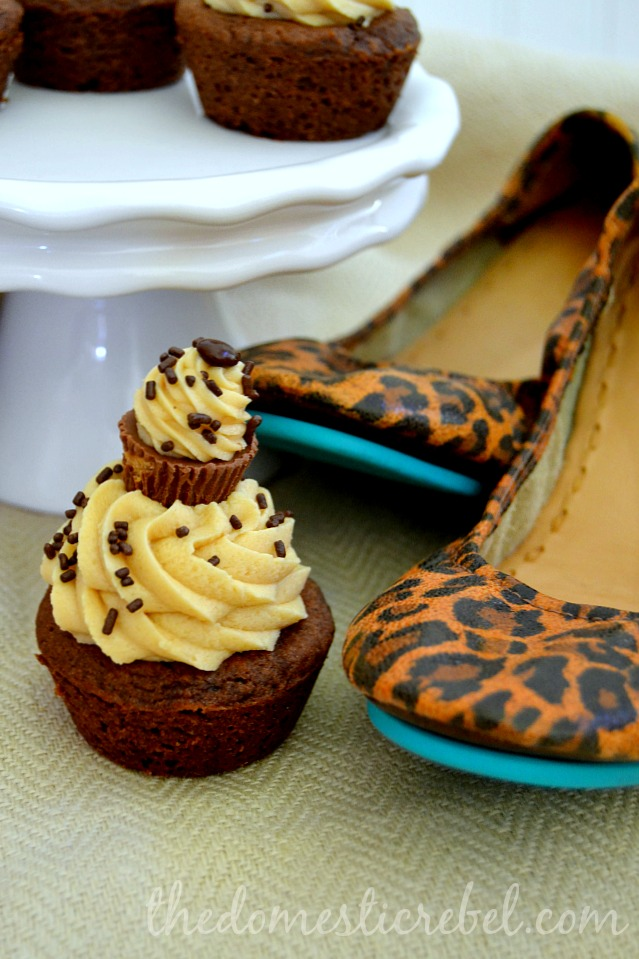 chocolate cookie cups with peanut butter cheesecake frosting with leopard print shoes