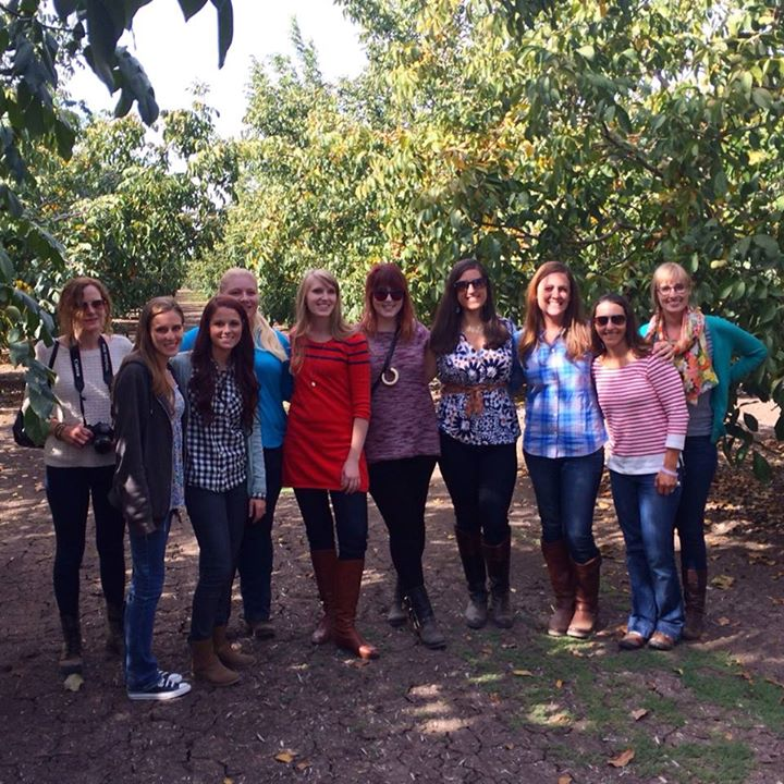 photo of author with fellow food bloggers at diamond california orchards