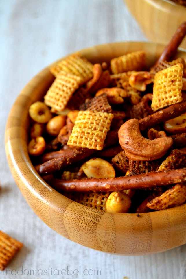 Perfect Chex Mix closeup in a wooden bowl on white background