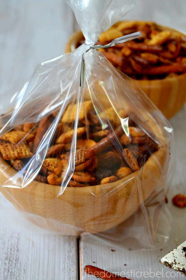 Perfect Chex Mix in a wooden bowl tied with cellophane