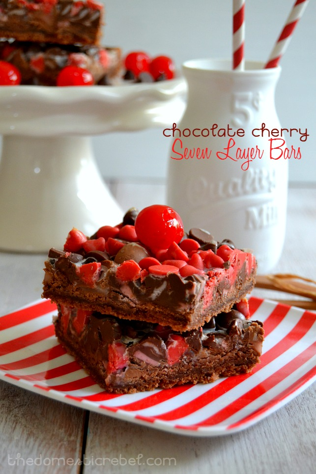 chocolate cherry seven layer bars stacked on red and white plate with milk glass in background