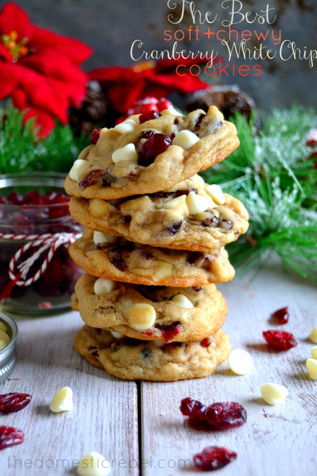 white chocolate cranberry cookies stacked with pine needles in background