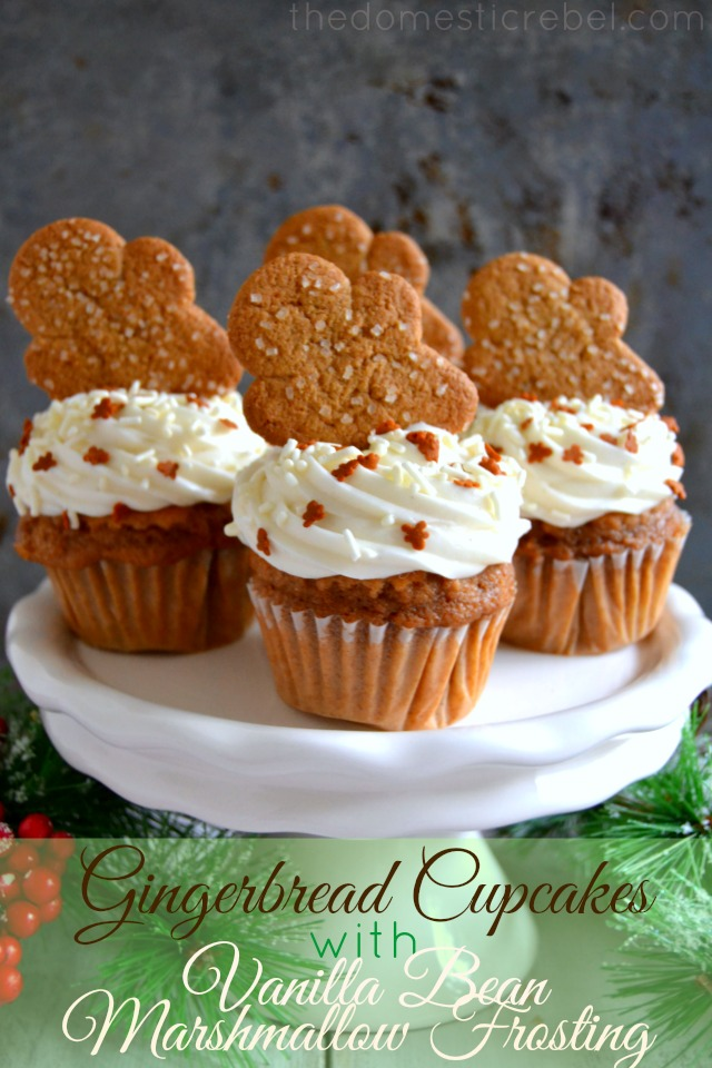 gingerbread cupcakes arranged on white cake stand with pine needles on metal background