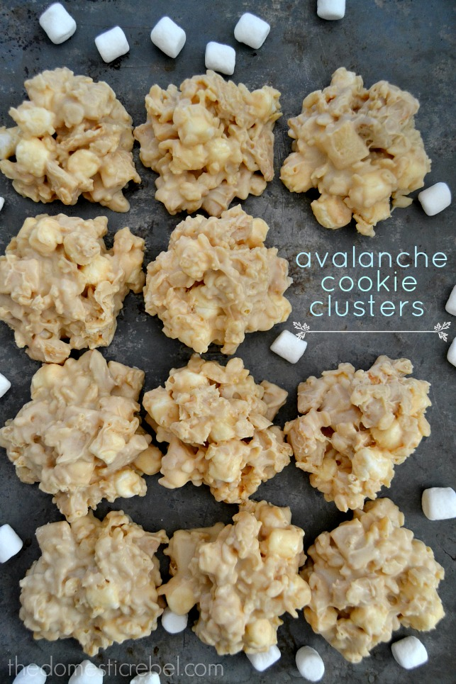 Avalanche Cookie Clusters arranged in a grid pattern with marshmallows on metal cookie sheet