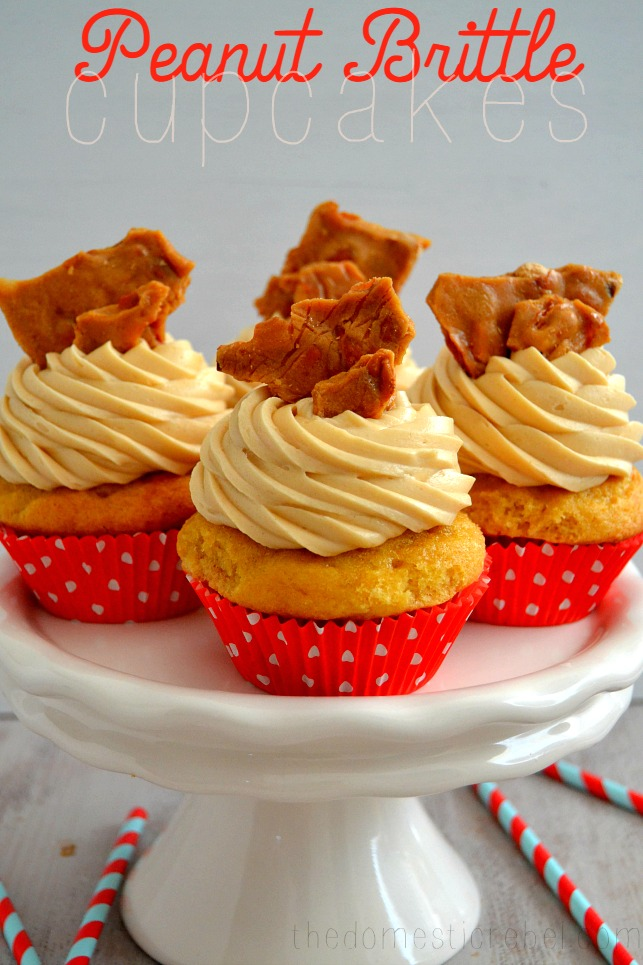 Peanut Brittle Cupcakes arranged on white cake stand in white background