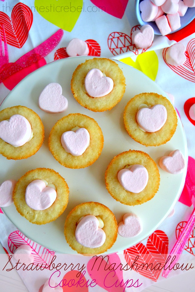 Strawberry Marshmallow Cookie Cups arranged on white plate with pink hearts in background