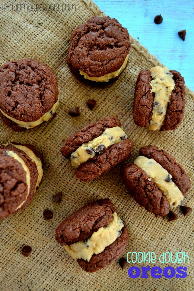 Chocolate Chip Cookie Dough Oreos arranged on burlap fabric with chocolate chips