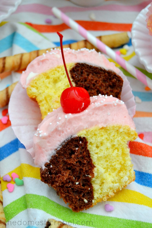 Neapolitan Cupcakes cut in half to show detail on rainbow background