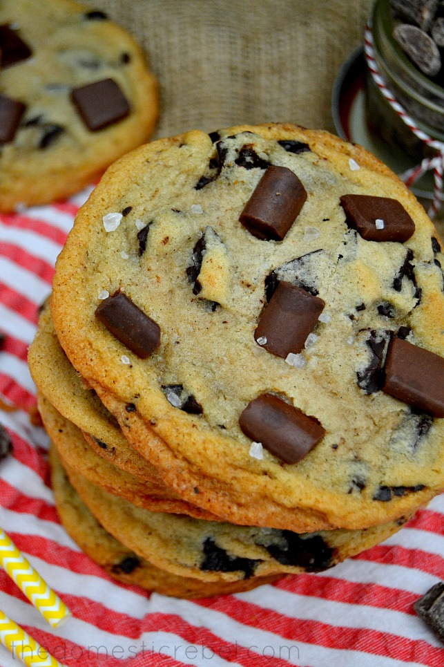 XXL Brown Butter Chocolate Chunk Cookies stacked on red and white striped fabric