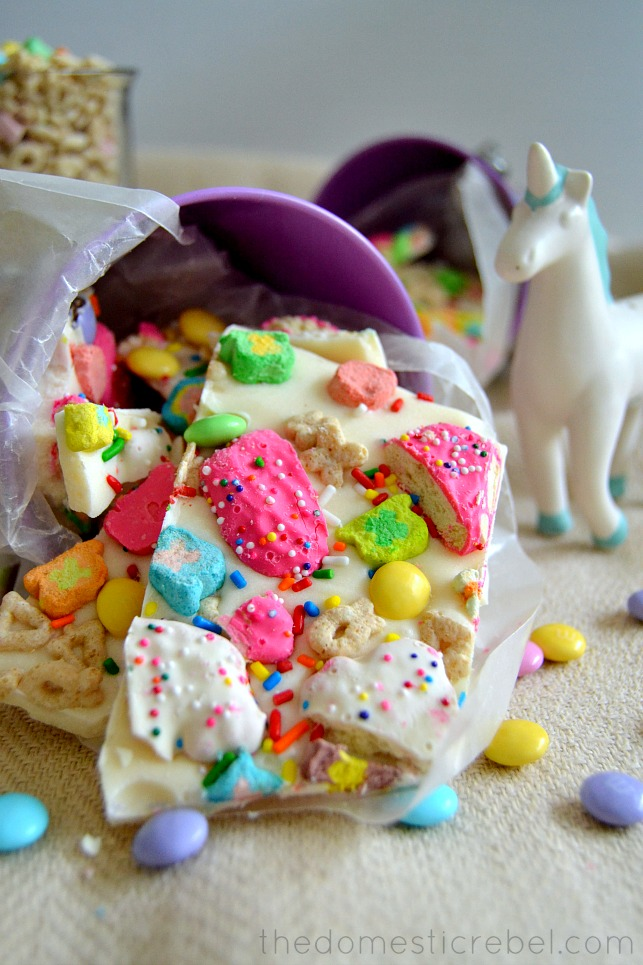 Lucky Rainbow Bark arranged in cup with unicorn figurine in background