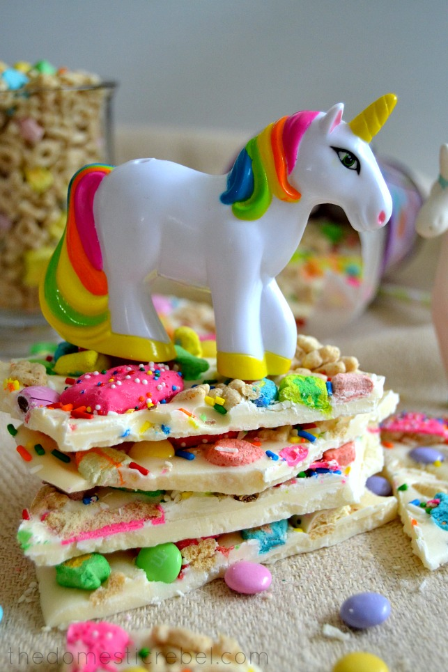 Lucky Rainbow Bark stacked with unicorn figurine standing on top of candy